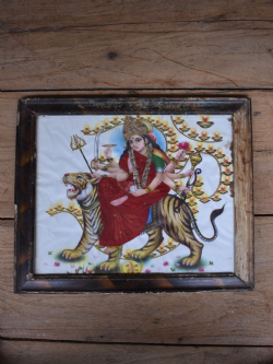 Vintage depiction of the Goddess Durga Riding a Tiger